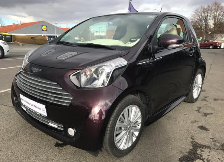ASTON MARTIN CYGNET (12/2011) - DEEP RED METALLIC - lieu:
