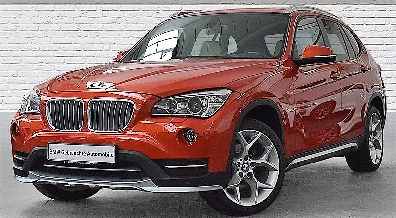 lhd BMW X1 (03/2014) - RED METALLIC - lieu: