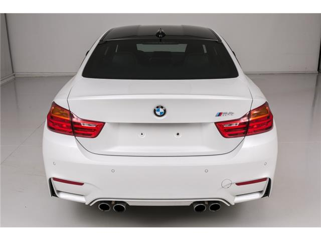 Left hand drive car BMW M4 (02/2017) - white - lieu: