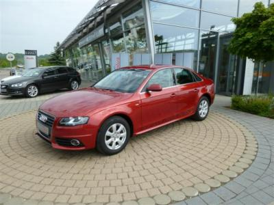 lhd AUDI A4 (03/2010) - Metallic Granite Red Pearl - lieu: